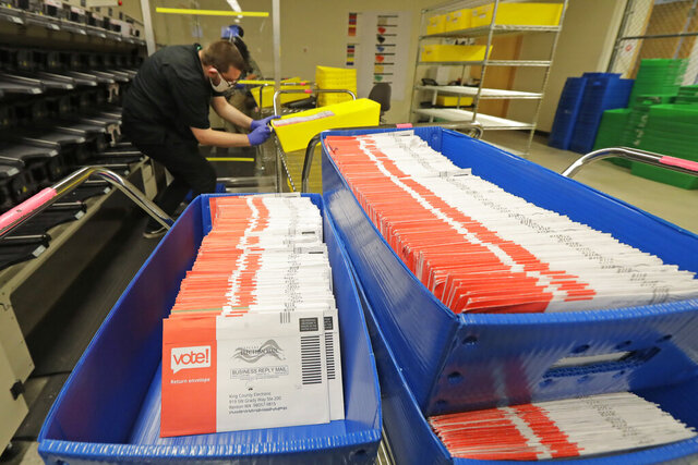 FILE - In this Aug. 5, 2020, file photo, vote-by-mail ballots are shown in sorting trays at the King County Elections headquarters in Renton, Wash., south of Seattle. Washington state saw its highest primary turnout in more than five decades, with 55% of the state's 4.6 million voters returning ballots for last week's election. While the final turnout number won't be known until Aug. 20, when the election is certified, as of Tuesday, Aug. 11, 2020, nearly 53% of the ballots have been processed, with just over 53,000 remaining. (AP Photo/Ted S. Warren, File)