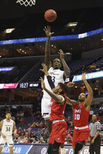 Cincinnati's Nyster Brooks of Cincinnati shoots the ball over SMU's Jimmy Whitt and Jarrey Foster during the first half of an NCAA college basketball game at the American Athletic Conference men's tournament Friday, March 15, 2019, in Memphis, Tenn. (AP Photo/Troy Glasgow)