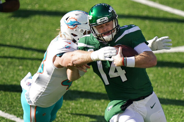 Miami Dolphins' Andrew Van Ginkel, left, tackles New York Jets quarterback Sam Darnold during the first half of an NFL football game, Sunday, Nov. 29, 2020, in East Rutherford, N.J. (AP Photo/Corey Sipkin)