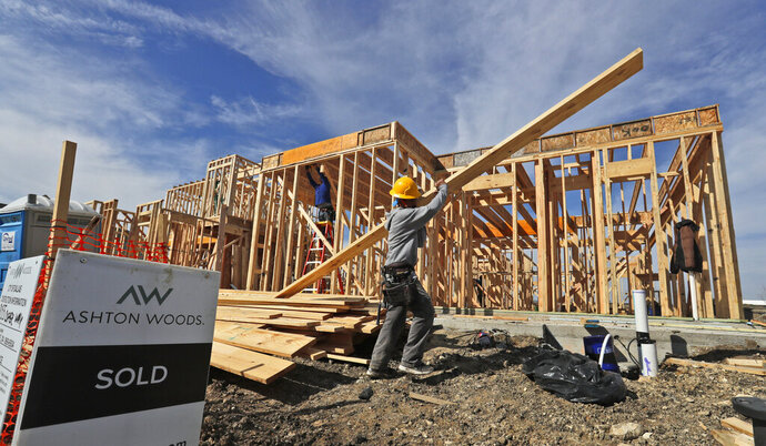 FILE - In this Wednesday, Feb. 20, 2019, file photo, a construction crew works on an already-sold new home in north Dallas. Homebuyers in some of the biggest U.S. cities are seeing a pickup in the number of homes for sale, especially in the most affordable segment of the market. (AP Photo/LM Otero, File)