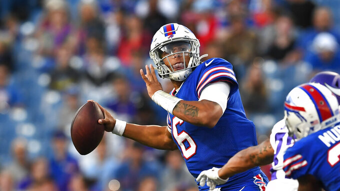 Buffalo Bills quarterback Tyree Jackson prepares to throw a pass during the first half of the team's NFL preseason football game against the Minnesota Vikings in Orchard Park, N.Y., Thursday, Aug. 29, 2019. (AP Photo/David Dermer)