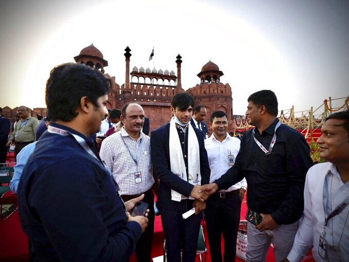 Olympic medalist Neeraj Chopra, center, arrives for the Independence Day celebrations at the historic 17th century Red Fort in New Delhi, India, on Sunay, Aug. 15, 2021. India commemorates its 1947 independence from British colonial rule on Aug. 15. (AP Photo/Manish Swarup)
