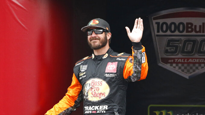 Monster Energy NASCAR Cup Series driver Martin Truex Jr. (19) waves at driver introductions during a NASCAR Cup Series auto race at Talladega Superspeedway, Sunday, Oct. 14, 2019, in Talladega, Ala. (AP Photo/Butch Dill)