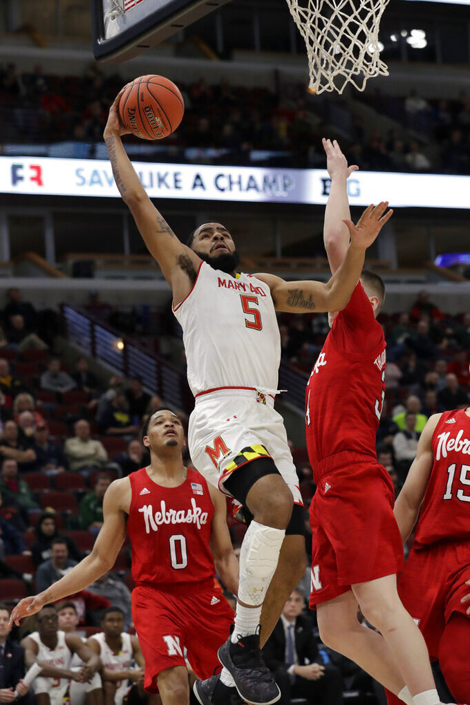 Maryland's Eric Ayala (5) goes up for a basket during the second half of an NCAA college basketball game against the Nebraska in the second round of the Big Ten Conference tournament, Thursday, March 14, 2019, in Chicago. (AP Photo/Nam Y. Huh)