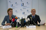 Federal Prosecutor Spokespersons Wenke Roggen, left, and Eric Van Duyse read a press release at the Belgium Federal Prosecutor Office in Brussels, Thursday, Oct. 11, 2018. Belgian authorities charged five people Thursday in relation to a massive financial fraud and match-fixing probe into soccer. (AP Photo/Francisco Seco)