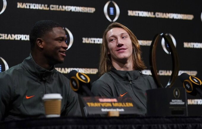Clemson's Trayvon Mullen and Trevor Lawrence answer questions at a news conference for the NCAA college football playoff championship game Tuesday, Jan. 8, 2019, in San Jose, Calif. (AP Photo/Morry Gash)