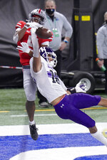 Northwestern defensive back Brandon Joseph (16) intercepts a pass intended for Ohio State wide receiver Garrett Wilson in the end zone during the first half of the Big Ten championship NCAA college football game, Saturday, Dec. 19, 2020, in Indianapolis. (AP Photo/AJ Mast)