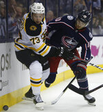 Boston Bruins' Charlie McAvoy, left, and Columbus Blue Jackets' Alexander Wennberg, of Sweden, fight for position during the second period of Game 3 of an NHL hockey second-round playoff series Tuesday, April 30, 2019, in Columbus, Ohio. (AP Photo/Jay LaPrete)