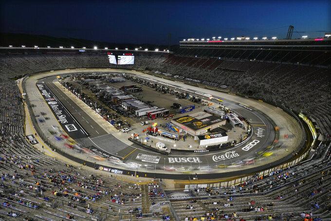 Cars circle the track during a NASCAR Xfinity Series auto race at Bristol Motor Speedway Friday, Sept. 17, 2021, in Bristol, Tenn. (AP Photo/Mark Humphrey)