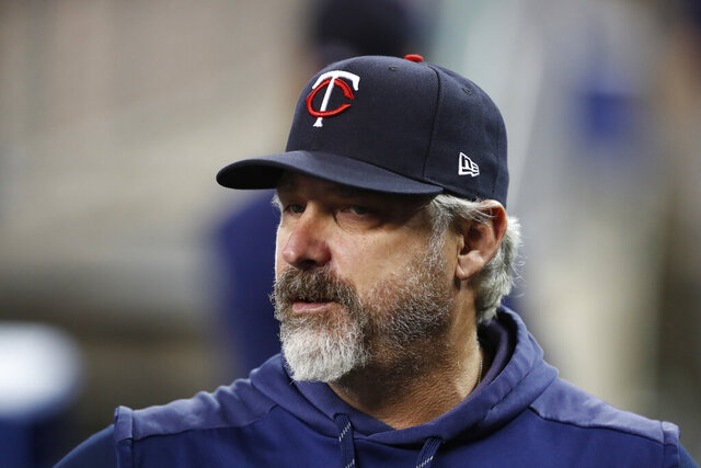 FILE- In this Aug. 30, 2019, file photo, Minnesota Twins bench coach Derek Shelton watches from the dugout during a baseball game against the Detroit Tigers in Detroit. Shelton is the new manager of the Pittsburgh Pirates, the team announced Wednesday, Nov. 27, 2019. Shelton replaces Clint Hurdle, who was fired on the final day of the regular season in September following a second-half collapse that dropped the Pirates to a last-place finish in the National League Central. (AP Photo/Carlos Osorio, File)