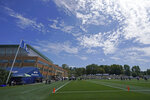 The 12 flag flies as Seattle Seahawks players take part in NFL football practice under blue skies Wednesday, July 28, 2021, in Renton, Wash. (AP Photo/Ted S. Warren)
