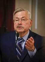 FILE - In this Friday, June 14, 2019, file photo, former Iowa governor and current U.S. Ambassador to China Terry Branstad testifies in the trial of a former state official who argues his pay was cut as part of an effort to force him out because he is gay, at the Polk County Courthouse in Des Moines, Iowa. Branstad and a staffer discriminated against the state's then-commissioner of workers' compensation, Chris Godfrey, in 2011 because he's gay, and the ex-official is entitled to $1.5 million for emotional distress, a jury said Monday, July 15, 2019. (Bryon Houlgrave/The Des Moines Register via AP, File)