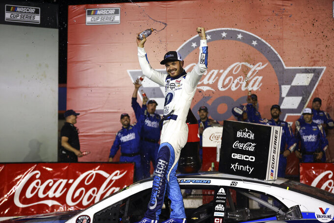 NASCAR Cup Series driver Kyle Larson celebrates in victory lane after winning the NASCAR Cup Series auto race at Charlotte Motor Speedway in Concord, N.C., late Sunday, May 30, 2021. (AP Photo/Nell Redmond)
