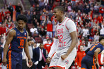 Ohio State's E.J. Liddell, right, celebrates after making a basket against Illinois during the second half of an NCAA college basketball game Thursday, March 5, 2020, in Columbus, Ohio. Ohio State won 71-63. (AP Photo/Jay LaPrete)