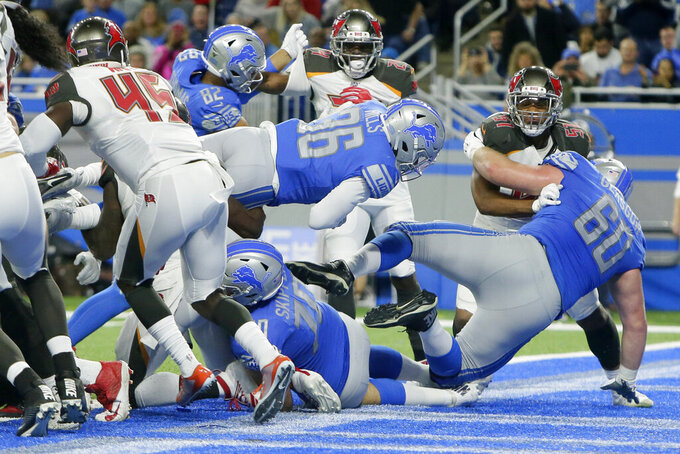 Detroit Lions running back Wes Hills (36) crosses the goal line for a 1-yard touchdown during the second half of an NFL football game against the Tampa Bay Buccaneers, Sunday, Dec. 15, 2019, in Detroit. (AP Photo/Duane Burleson)