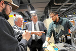FILE - In this Tuesday, April 10, 2018, file photo, Ken Broadbent, second from left, business manager of the Pittsburgh Steamfitters Local 449, gives a tour at the new Steamfitters Local Union 449 Technology Center in Harmony, Pa. Some key labor leaders say they are starting to worry about the topics dominating the 2020 conversation.