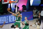 Boston Celtics' Jayson Tatum (0) heads to the basket during the first half of an NBA basketball game against the Milwaukee Bucks Friday, July 31, 2020, in Lake Buena Vista, Fla. (AP Photo/Ashley Landis, Pool)