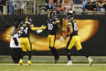 Pittsburgh Steelers wide receiver Johnny Holton (80) is congratulated by running back Benny Snell (24) and tight end Zach Gentry (81) during the first half of an NFL preseason football game in Charlotte, N.C., Thursday, Aug. 29, 2019. (AP Photo/Mike McCarn)