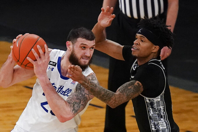 Georgetown's Jamorko Pickett, right, defends against Seton Hall's Sandro Mamukelashvili during the first half of an NCAA college basketball game in the semifinals in the Big East men's tournament Friday, March 12, 2021, in New York. (AP Photo/Frank Franklin II)