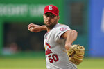 St. Louis Cardinals starting pitcher Adam Wainwright delivers in the first inning of the team's baseball game against the Cleveland Indians, Tuesday, July 27, 2021, in Cleveland. (AP Photo/Tony Dejak)