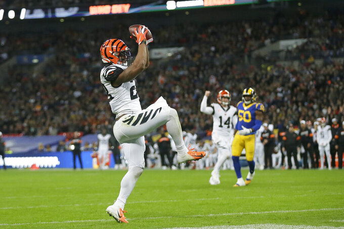 Cincinnati Bengals running back Joe Mixon (28) scores against the Los Angeles Rams during the first half of an NFL football game, Sunday, Oct. 27, 2019, at Wembley Stadium in London. (AP Photo/Tim Ireland)