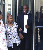 Former Nevada Senate Majority Leader Kelvin Atkinson, right, who pleaded guilty to misusing campaign funds, leaves the Lloyd D. George U.S. Courthouse after his sentencing on Thursday, July 18, 2019, in Las Vegas. Atkinson resigned from the Legislature in March and pleaded guilty less than a week later to federal wire fraud. (Bizuayehu Tesfaye/Las Vegas Review-Journal via AP)