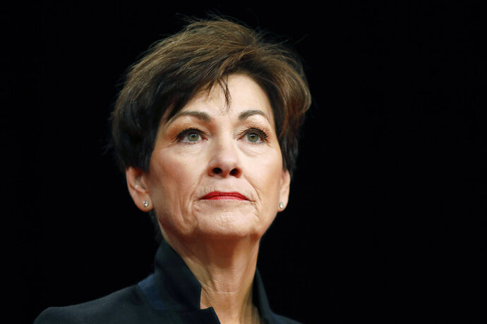 FILE - In this Jan. 18, 2018, file photo, Iowa Gov. Kim Reynolds delivers her inaugural address in Des Moines, Iowa. Reynolds said Monday, Feb. 18, 2019, she decided against appealing a judge's ruling last month that struck down Iowa's