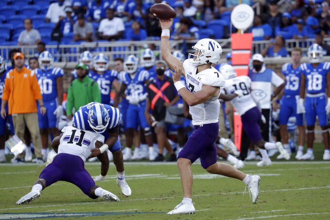Northwestern quarterback Andrew Marty (7) passes during the second half of an NCAA college football game against Duke in Durham, N.C., Saturday, Sept. 18, 2021. (AP Photo/Chris Seward)