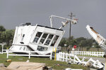 CORRECTS YEAR TO 2019-Power company lineman work to restore power after a tornado hit Emerald Isle N.C. as Hurricane Dorian moved up the East coast on Thursday, Sept. 5, 2019. (AP Photo/Tom Copeland)