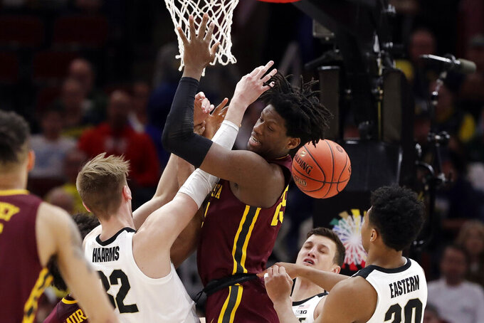 Purdue's Matt Haarms (32) and Minnesota's Daniel Oturu (25) battle for a rebound during the second half of an NCAA college basketball game in the quarterfinals of the Big Ten Conference tournament, Friday, March 15, 2019, in Chicago. (AP Photo/Nam Y. Huh)