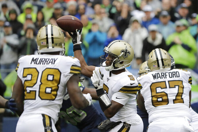 New Orleans Saints quarterback Teddy Bridgewater, center, throws against the Seattle Seahawks during the first half of an NFL football game Sunday, Sept. 22, 2019, in Seattle. (AP Photo/Ted S. Warren)
