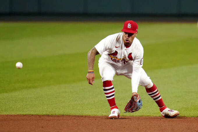 FILE - In this Sept. 11, 2020, file photo, St. Louis Cardinals second baseman Kolten Wong handles a sharp grounder by Cincinnati Reds' Nick Castellanos during the fifth inning of a baseball game in St. Louis. The Cardinals have declined Wong's $12.5 million option, making the Gold Glove second baseman a free agent. The 30-year-old Wong will receive a $1 million buyout. Wong, a first-round pick in the 2011 draft, made his big league debut in 2013 and spent his first eight seasons with St. Louis. (AP Photo/Jeff Roberson, File)