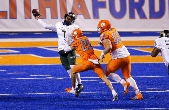 Colorado State quarterback Todd Centeio (7) throws the ball as he is hit by Boise State's Kekaula Kaniho (28) during the fourth quarter of an NCAA college football game Thursday, Nov. 12, 2020, in Boise, Idaho. Boise State won 52-21. (AP Photo/Steve Conner)