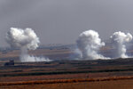 In this photo taken from the Turkish side of the border between Turkey and Syria, in Akcakale, Sanliurfa province, southeastern Turkey, smoke billows from targets inside Syria during bombardment by Turkish forces Thursday, Oct. 10, 2019. (AP Photo/Lefteris Pitarakis)