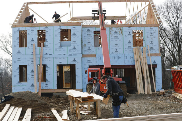 FILE- In this Jan. 4, 2019, file work continues on a plan of new homes in Franklin Park, Pa.  U.S. productivity rebounded in the final three months of 2019, helping to boost productivity growth for the year to the best showing in nearly a decade. The Commerce Department said Thursday, Feb. 6, 2020 that productivity grew at an annual rate of 1.4% in the October-December quarter, a significant improvement from a 0.2% drop in productivity in the third quarter. (AP Photo/Keith Srakocic, File)