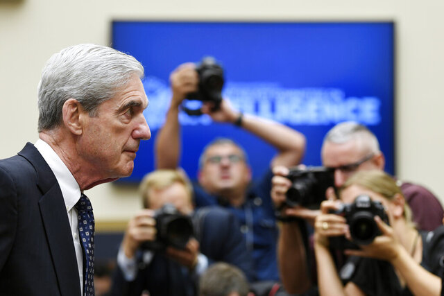 FILE - In this Wednesday, July 24, 2019, file photo, former special counsel Robert Mueller returns to the witness table following a break in his testimony before the House Intelligence Committee on Capitol Hill in Washington. NBC announced Wednesday, Dec. 2, 2020, that Mueller, the former special counsel who looked into Russian interference in the 2016 election, has given an extensive interview that debuts in early December. (AP Photo/Susan Walsh, File)