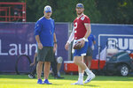 Indianapolis Colts quarterback Carson Wentz (2) talks with head coach Frank Reich during practice at the NFL team's football training camp in Westfield, Ind., Monday, Aug. 23, 2021. (AP Photo/Michael Conroy)