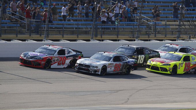 Christopher Bell, left, leads early in the NASCAR Xfinity Series auto race, Saturday, July 27, 2019, at Iowa Speedway in Newton, Iowa. (AP Photo/Matthew Putney)