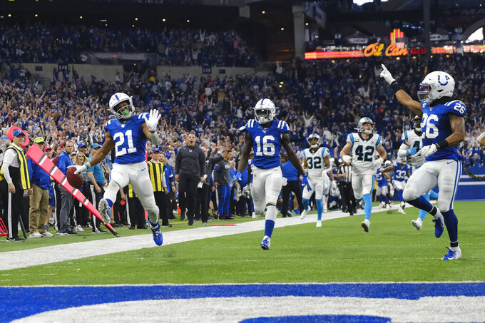 Indianapolis Colts' Nyheim Hines (21) celebrates as he runs back a punt for a touchdown during the second half of an NFL football game against the Carolina Panthers, Sunday, Dec. 22, 2019, in Indianapolis. (AP Photo/AJ Mast)