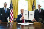 President Donald Trump holds up a signed executive order to increase sanctions on Iran, in the Oval Office of the White House, Monday, June 24, 2019, in Washington. Trump is accompanied by Treasury Secretary Steve Mnuchin, left, and Vice President Mike Pence. (AP Photo/Alex Brandon)