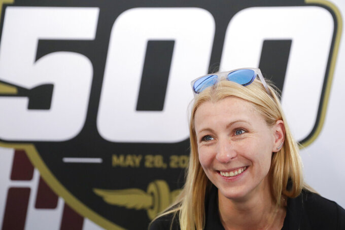 Pippa Mann, of England, answers a question during driver interviews for the Indianapolis 500 IndyCar auto race at Indianapolis Motor Speedway, Thursday, May 23, 2019, in Indianapolis. (AP Photo/Michael Conroy)
