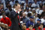 Cincinnati coach John Brannen directs his players from the bench area during the first half of an NCAA college basketball game against Xavier, Saturday, Dec. 7, 2019, in Cincinnati. (AP Photo/John Minchillo)