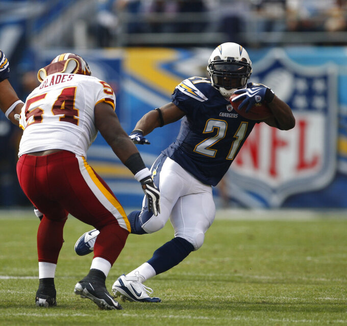 FILE - In this Sunday, Jan. 3, 2010 file photo, San Diego Chargers running back LaDainian Tomlinson during the first quarter of an NFL football game in San Diego. After shutting down receivers during his Hall of Fame career, Aeneas Williams, the former Cardinals and Rams defensive back, hosts the NFL Legends podcast, a platform for former players to share their stories, encourage each other and learn about programs available to them. Tomlinson was a guest on the podcast last month. He talked to Williams about his charity foundation and his commitment to social justice issues. (AP Photo/Lenny Ignelzi, File)