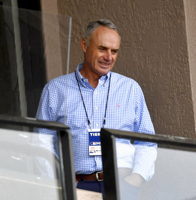 Major League Baseball commissioner Rob Manfred watches as the Pirates take on the Tigers Saturday, March 20, 2021, at Publix Field at Joker Marchant Stadium in Lakeland, Fla. (Matt Freed /Pittsburgh Post-Gazette via AP)