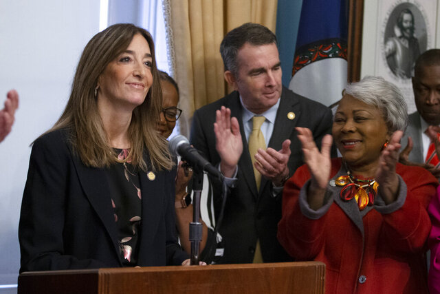 Virginia House of Delegates speaker-designate, Eileen Filler-Corn, left, and Virginia Gov. Ralph Northam, center, along with State Sen. Louise Lucas, D-Portsmouth, right, applaud during remarks on their legislative agenda at the Capitol in Richmond, Va., Tuesday, Jan. 7, 2020. (AP Photo/Steve Helber)