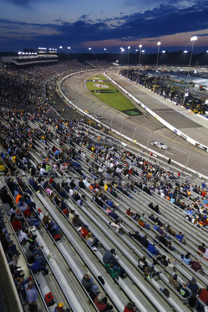 Race fans wait for the start of the NASCAR Cup series auto race at Richmond Raceway in Richmond, Va., Saturday, April 13, 2019. (AP Photo/Steve Helber)