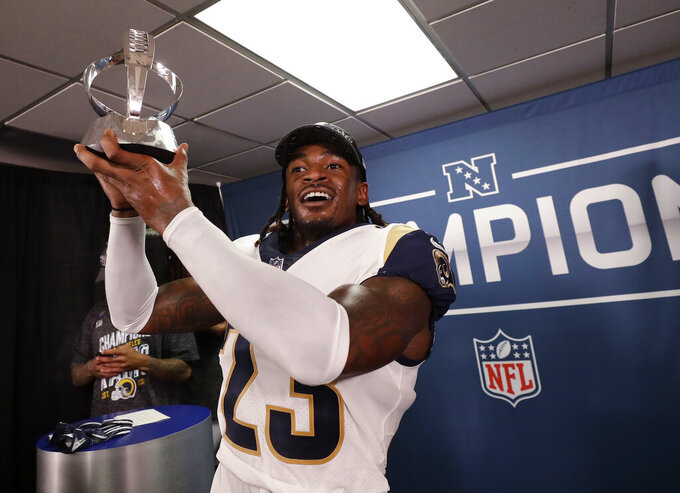 Los Angeles Rams defensive back Nickell Robey-Coleman celebrates with he NFC trophy after overtime of the NFL football NFC championship game against the New Orleans Saints, Sunday, Jan. 20, 2019, in New Orleans. The Rams won 26-23. (AP Photo/David J. Phillip)