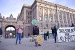Swedish climate activist Greta Thunberg, center, holding a sign reading