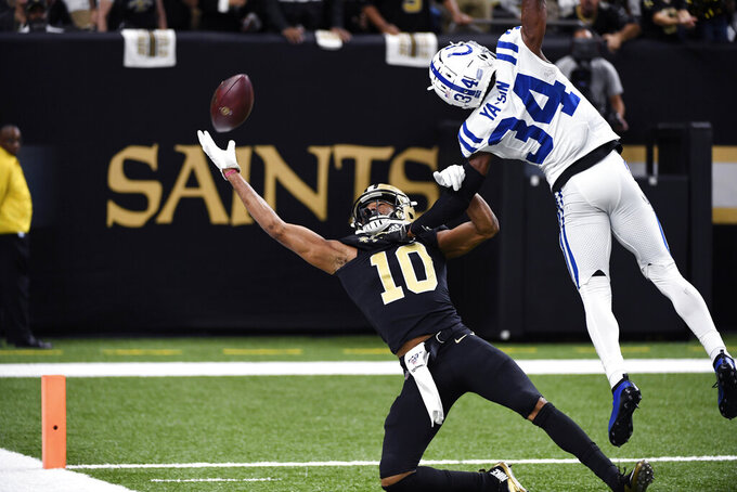 New Orleans Saints wide receiver Tre'Quan Smith (10) tries but fails to pull in a pass as Indianapolis Colts cornerback Rock Ya-Sin (34) covers in the first half of an NFL football game in New Orleans, Monday, Dec. 16, 2019. (AP Photo/Bill Feig)