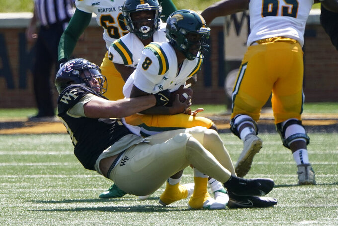 Norfolk State quarterback Juwan Carter is sacked by Wake Forest defensive lineman Rondell Bothroyd during the first half of a NCAA college football game Saturday, Sept. 11, 2021, in Winston-Salem, N.C. (AP Photo/Chris Carlson)